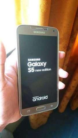 Samsung Galaxy s5 Grande New edition Dorado con los accesorios